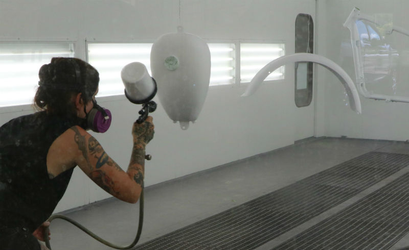 Painting the tins in a paint booth